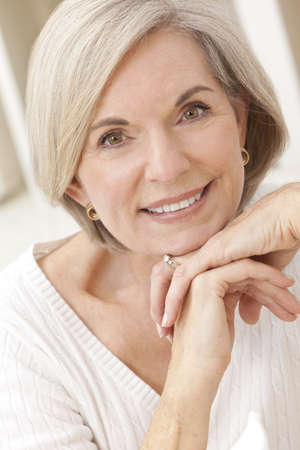 Portrait of an attractive elegant senior woman relaxing at home. photo