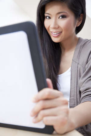 Beautiful Asian Chinese Woman Using Tablet Computer Stock Photo - 10054765