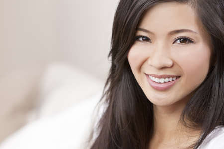 dental smile: A beautiful young Chinese Asian Oriental woman with a wonderful toothy smile  Stock Photo