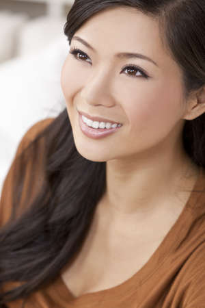 toothy: A beautiful young Chinese Asian Oriental woman with a wonderful toothy smile  Stock Photo