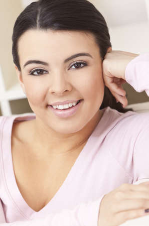 Indoor portrait of a beautiful young Latina Hispanic woman smiling photo