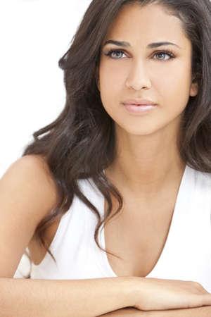 Studio portrait of a beautiful young Latina Hispanic young woman or girl looking thoughtful