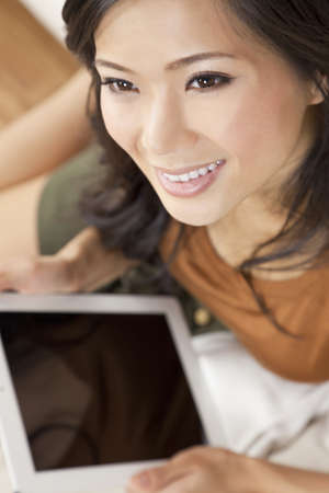 sexy asian woman: Beautiful Asian Chinese Woman Using Tablet Computer