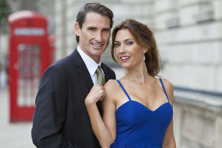 Romantic man and woman couple by a traditional red phone box, London, England, Great Britain Stock Photo