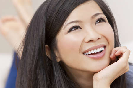 giggle: Close up portrait of a beautiful young Chinese Asian Oriental woman  Stock Photo
