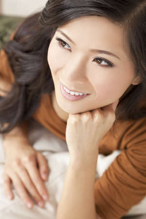 Portrait of a beautiful young Chinese Asian Oriental woman resting on her hand Stock Photo - 13031768