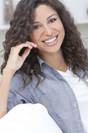 Studio portrait of a beautiful young Latina Hispanic woman relaxing   smiling