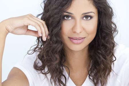 Studio portrait of a beautiful young Latina Hispanic woman smiling  Stock Photo