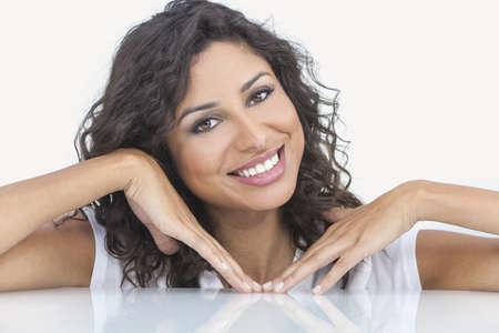 Studio portrait of a beautiful young Latina Hispanic woman smiling  Stock Photo