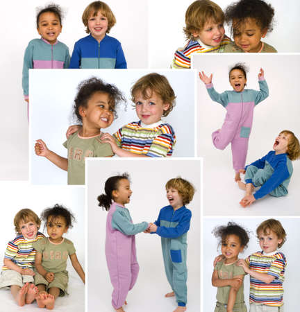 Two young children playing together laughing and holding hands Stock Photo