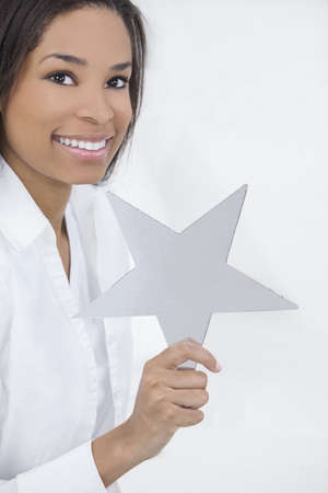 Beautiful young African American woman smiling, relaxing and holding a silver star Stock Photo - 14901947