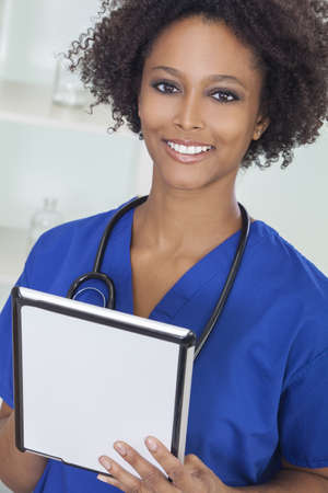 A black African American female medical doctor with stethoscope using a tablet computer in a hospital Stock Photo - 15784327