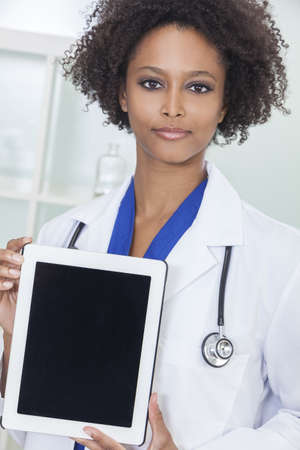 An African American female woman medical doctor with a tablet computer in hospital  photo