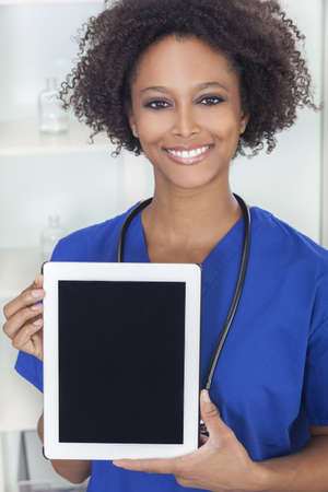 An African American female woman medical doctor with a tablet computer in hospital Stock Photo - 16299854