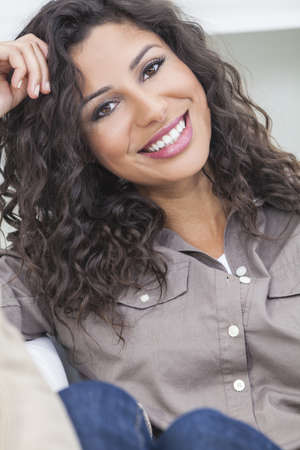 Studio portrait of a beautiful young Latina Hispanic woman smiling  Stock Photo - 16782677