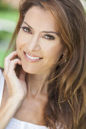 Outdoor portrait of a beautiful middle aged brunette woman in her forties Stock Photo - 16799778