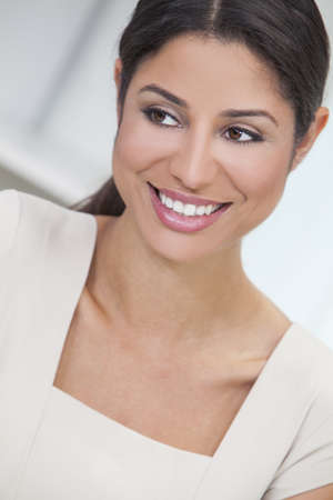 Portrait of a beautiful smart young Latina Hispanic woman or businesswoman smiling  Stock Photo - 17286177