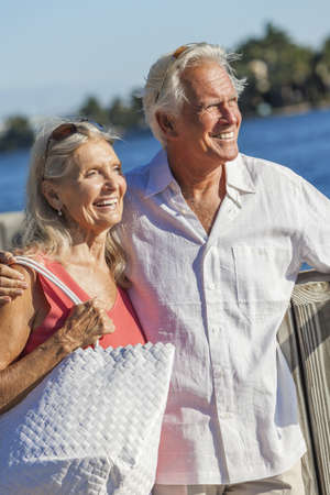 Happy senior man and woman romantic couple together looking out to tropical sea or river with bright clear blue sky Stock Photo - 17475682