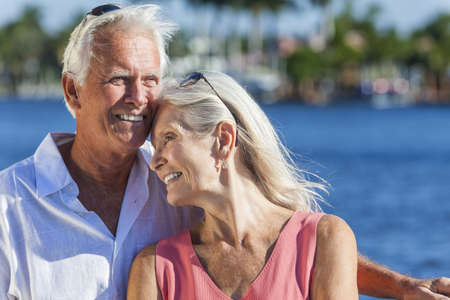 Happy romantic senior man and woman romantic couple together embracing by tropical sea or river Stock Photo - 17475684