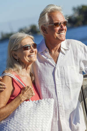Happy senior man and woman romantic couple together looking out to tropical sea or river with bright clear blue sky Stock Photo - 17475683