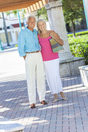 Happy senior man and woman couple walking together outside in sunshine Stock Photo - 17544337