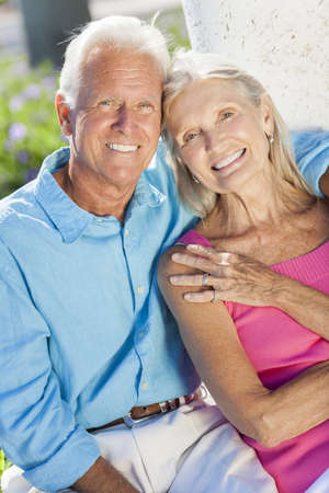 Happy senior man and woman couple sitting together outside in sunshine Stock Photo - 17544339