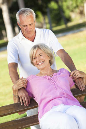 Happy senior man and woman couple smiling and laughing having fun together outside in sunshine Stock Photo - 18316841