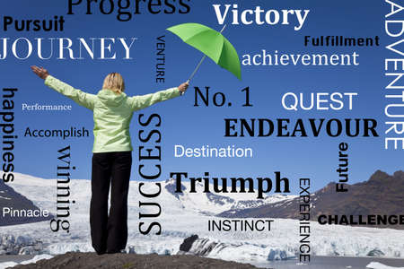 achievment: Environmental success concept shot of a woman with a green umbrella standing arms