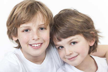 White background studio photograph of young happy boy children brothers smiling together Stock Photo - 19285148