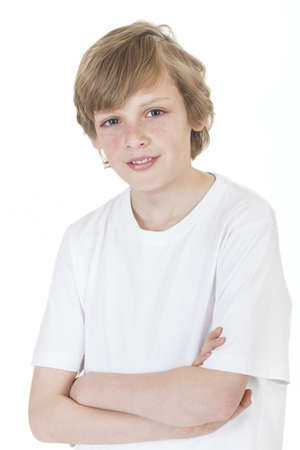 White background studio photograph of young happy boy smiling and arms folded Stock Photo - 19406924