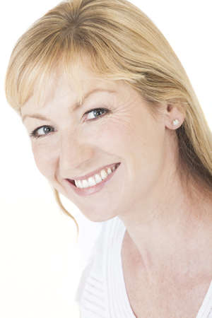 Studio portrait head shot of a happy smiling attractive middle aged blonde woman with perfect teeth Stock Photo - 19406930