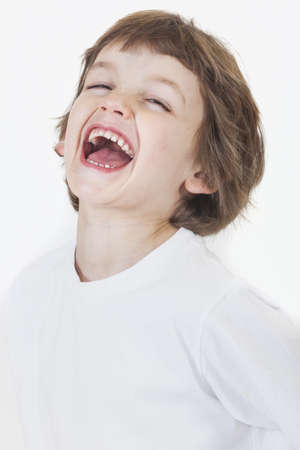 White background studio photograph of young happy boy laughing Stock Photo - 19406931