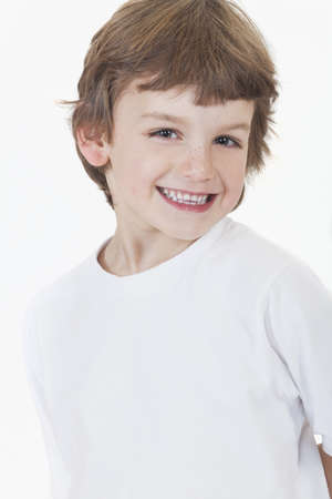 White background studio photograph of young happy boy smiling Stock Photo - 19406925