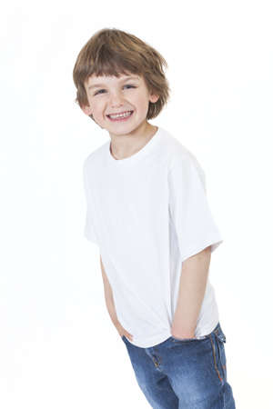 White background studio photograph of young happy boy smiling wearing blue denim jeans hands in pockets  Stock Photo - 19406933