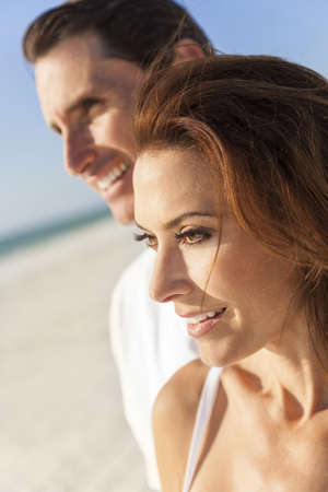 beautiful middle aged woman: Middle aged man & woman couple together in sunshine on a beautiful tropical beach