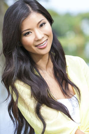 classy woman: Outdoor portrait of a beautiful young Chinese Asian young woman or girl
