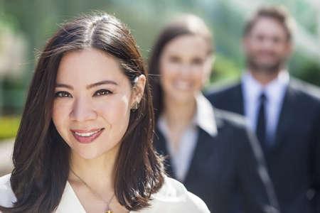 asian business team: Beautiful Asian Business woman and interracial group of business men & women, businessmen and businesswomen team