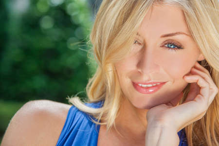 blonde  blue eyes: Portrait of naturally beautiful woman in her twenties with blond hair and blue eyes, shot outside in natural sunlight