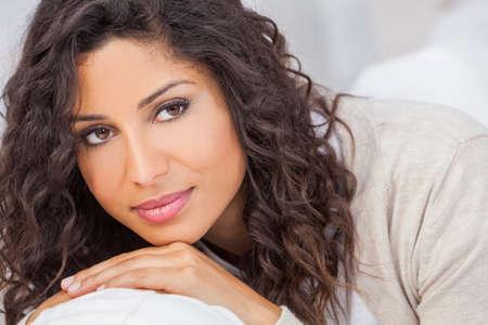 Studio portrait of a beautiful young mixed race Latina Hispanic woman smiling Stock Photo