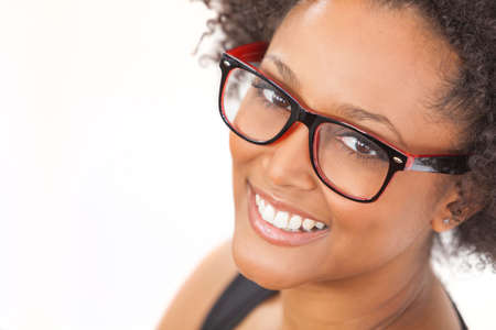 calm woman: A beautiful intelligent mixed race African American girl or young woman looking happy and wearing geek glasses