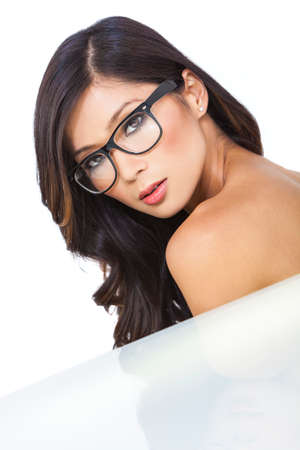 Portrait of a beautiful Chinese Asian girl or young woman wearing geek glasses photo