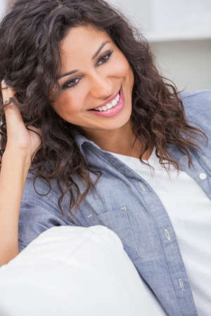Studio portrait of a beautiful young Latina Hispanic woman smiling  photo