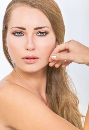 Portrait of a beautiful blond young woman with green eyes and blond hair photo