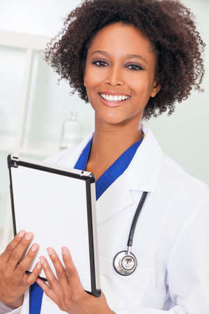 A black African American female medical doctor using a tablet computer in a hospital Stock Photo - 35089035