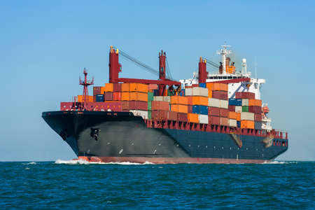 Container ship or boat sailing at sea
