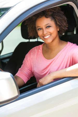 black car: Beautiful young mixed race black African American woman driving a car