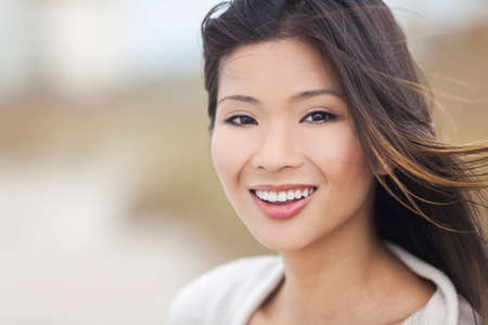 classy: Outdoor portrait of a beautiful young Chinese Asian young woman or girl with perfect teeth