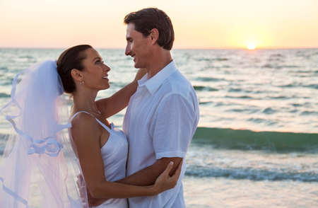 groom: A married couple, bride and groom, together sunset sunrise on a beautiful tropical beach