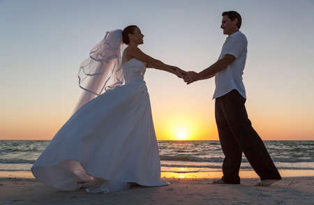 bride groom silhouette: A married couple, bride and groom, sunset sunrise wedding on a beautiful tropical beach