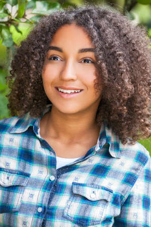 perfect teeth: Outdoor portrait of beautiful happy mixed race African American girl teenager female child smiling with perfect teeth